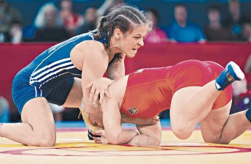 Тот самый поединок Стадник с Мерлени на Олимпиаде-2012 в Лондоне. Соперничество двух украинок закончилось в пользу той, что выступала под флагом Азербайджана. Фото: РЕЙТЕР.