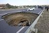 В яму на шоссе у Симферополя провалился автомобиль с детьми.