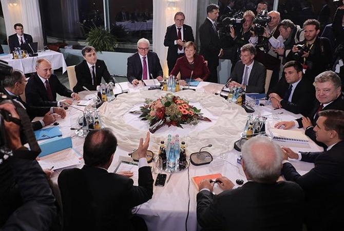Киев получит контроль над границей после выборов вДонбассе— Меркель