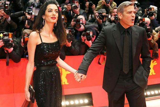 Джордж иАмаль Клуни приехали наВсемирный экономический форум вДавосе