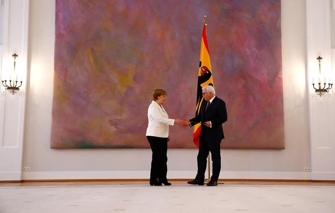 Меркель и президент Штайнмайер.